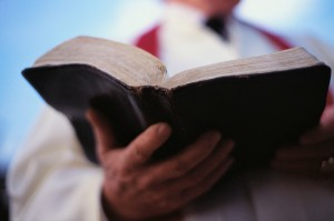 Pastor Holding Bible