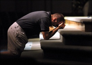 man praying at altar
